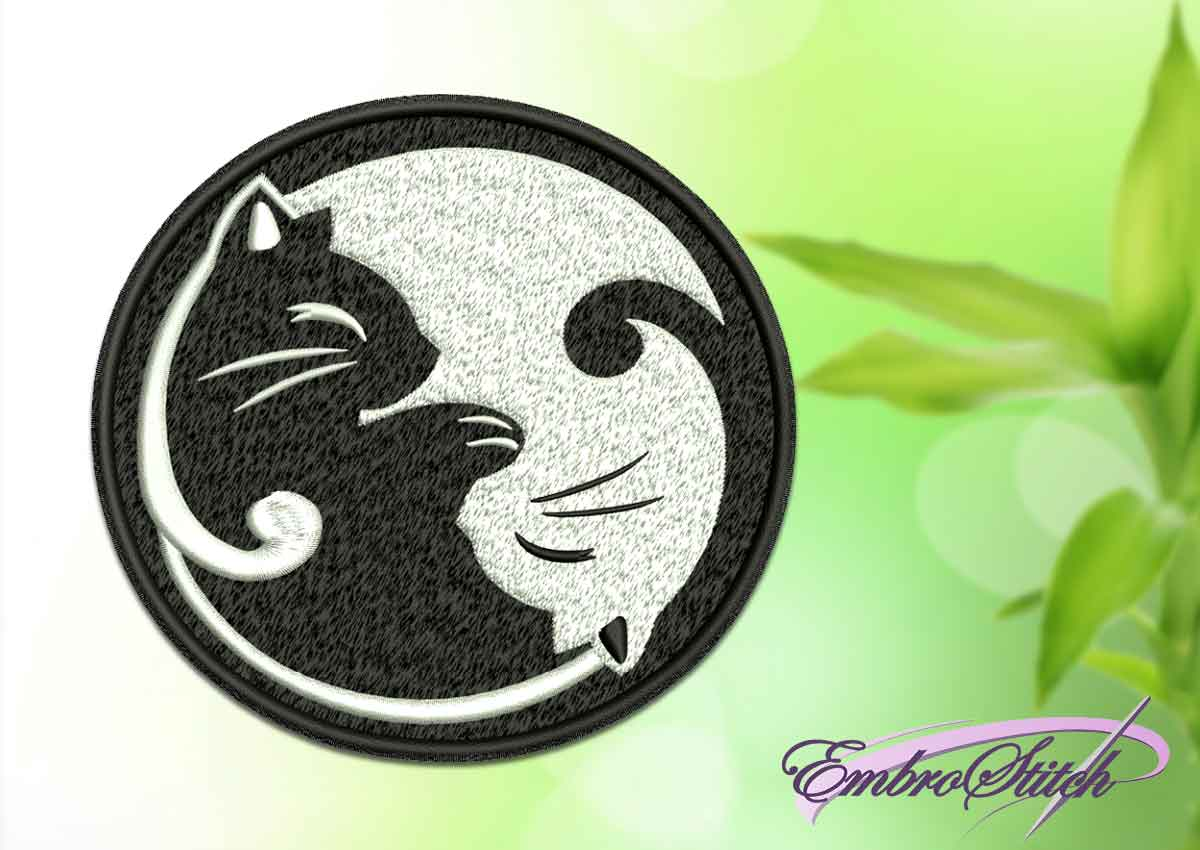 The embroidery design depicts Yin Yang with kittens